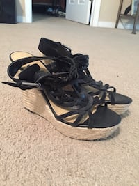 pair of black leather open-toe sandals Palm Coast, 32164