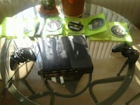Xbox 360 console with two cordless and corded cont