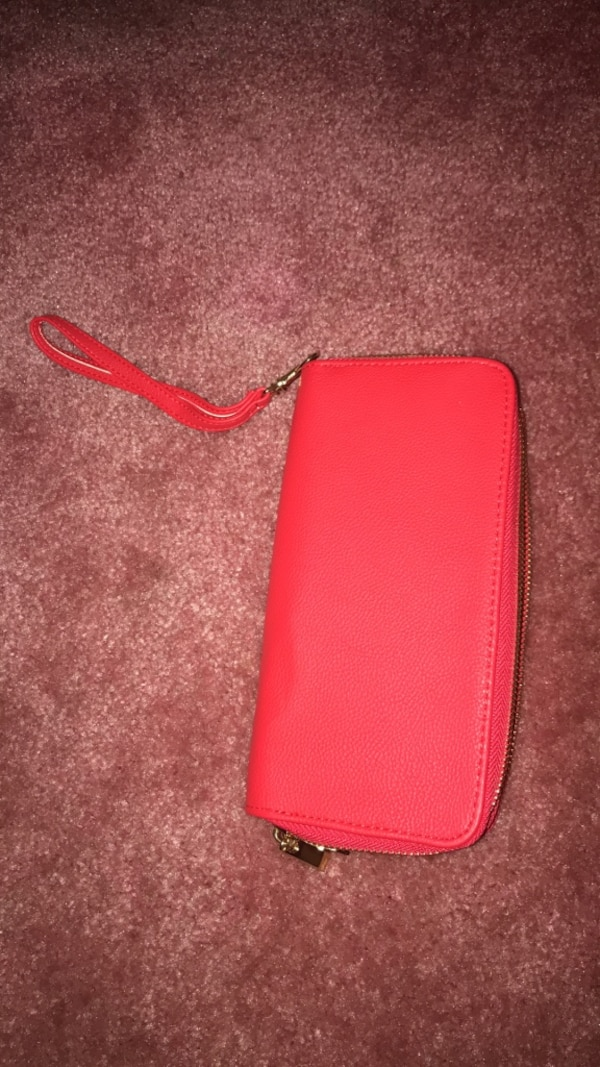 red leather bi-fold wallet