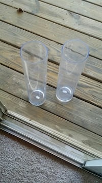 two clear cylindrical glass vases