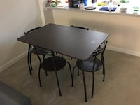 Rectangular black wooden table with four chairs dining set Arlington, 22203