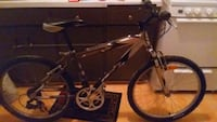 black and white full-suspension bike Winnipeg, R2M 3N4