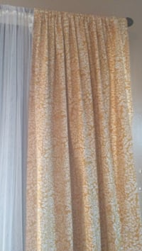 brown and white floral window curtain