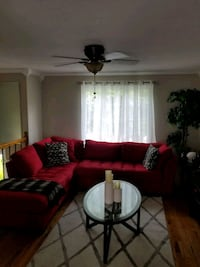 Red sectional, 1 end table, and coffee table White Plains