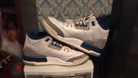 Pair of white-and-blue air jordan 4