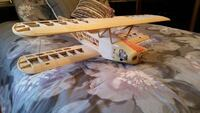 RC Airplanes -1 complete flyable PT 40, super tiger motor, 4 channel Airtronic radio.  1- Smith mini Bi Plane , .  New never used OS 70 4 stroke motor , 6 channel Airtronics Radiant.  All original boxes , parts and drawing. Sold as is