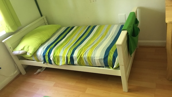 White wooden toddler cot- bed