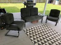 Black metal patio set with small table cushions are worn - Make offer