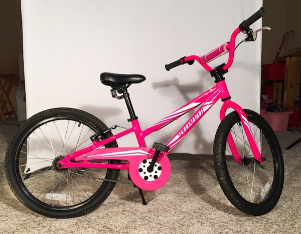 Pink and black 20 inch Specialized HotRock bike