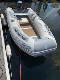 10 ft Zodiac with a 4 stroke 15 hp Yamaha out board.