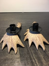 two black-and-brown candle holders