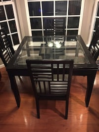 Square black wooden framed glass top 4 chairs and table dining set Leesburg, 20176