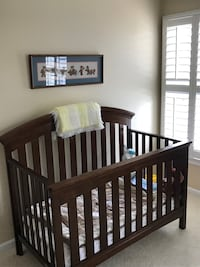 baby's brown wooden crib Snellville, 30078