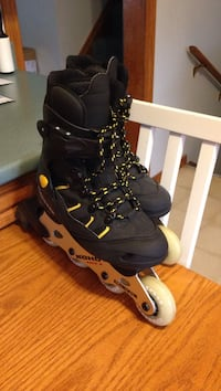 Black and yellow KOHO inline rollerblades. Size 6 women. Not worn outside at all.