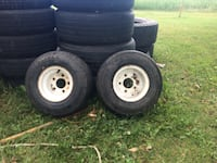 two white 5-lug vehicle wheel and tires