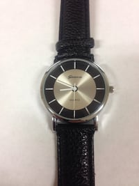 Round silver geneva analog watch with black leather strap