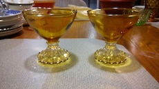 two yellow wine glasses