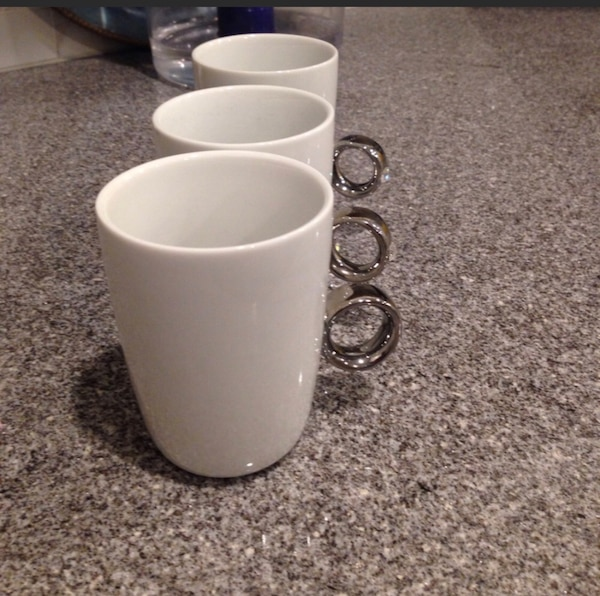 Two (2) FRED solitaire diamond coffee cups