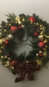 Beautiful Wreath with lights and bow tie.