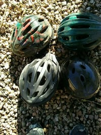 two blue and black bicycle helmets Albuquerque, 87111