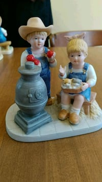 blue jumpsuit dress boy and girl ceramic figurines Logansport, 46947
