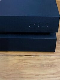 PS4 console And Two Controllers Black