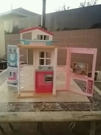 white and pink doll house Paramount