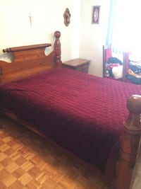 brown wooden bed frame with red bed comforter MONTREAL