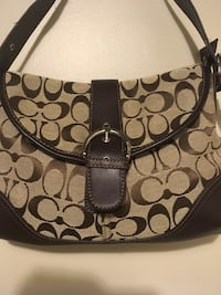 brown monogrammed Coach leather hobo bag