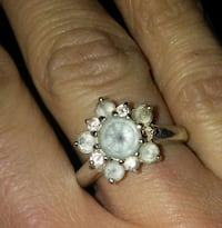 Silver ring with opal frost gem.