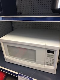 white General Electric microwave oven Chicago, 60647