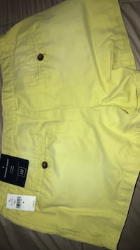 yellow button-up shirt Houston, 77009