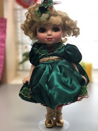 girl in black and green dress doll