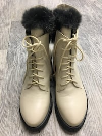 pair of white leather boots 2395 mi