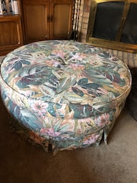 gray and white floral ottoman