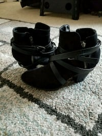 pair of black leather open toe ankle strap wedges