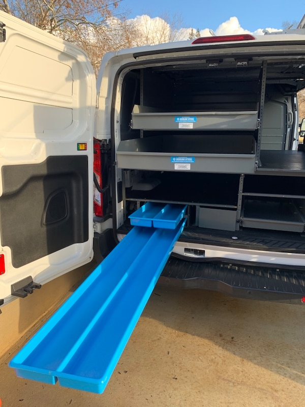 Adrian Steele work van shelves and partition a0c87604-3bb2-4189-bde3-623b3c09c9f4