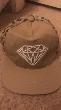 Beige and cougar printed hat with a diamond  Surrey, V3Z 1E3