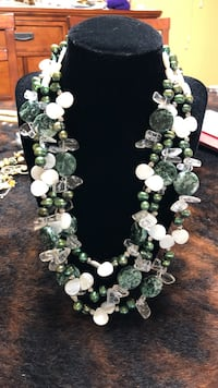 Iridescent green beads with white and clear stones. Grand Rivers, 42081