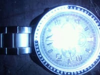 round silver-colored analog watch Calgary, T2R 0V7