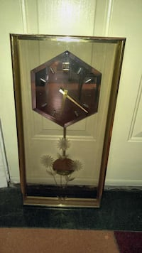 rectangular brown with hexagonal pendulum clock Calgary, T2G 3N1