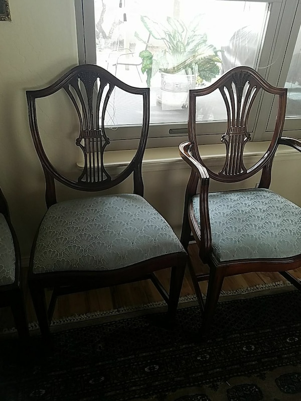 5 brown wooden framed blue hub padded chairs