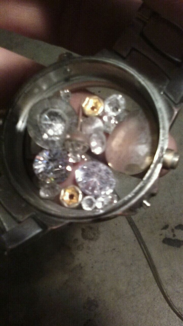 Found watch wit loose diamond if interestedmake of