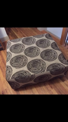 Beige and brown ottoman six months old. Great condition.