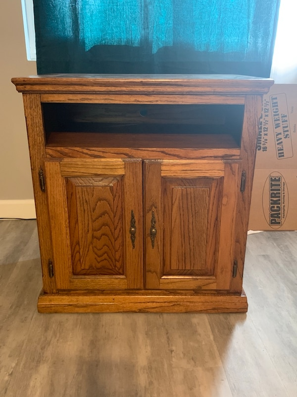brown wooden cabinet with cabinet