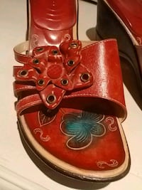 pair of red-and-white leather sandals