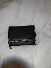Black leather never used roots wallet  London, N6B