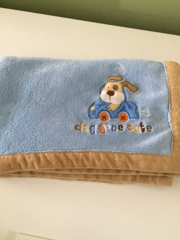 blue and brown Mickey Mouse print textile