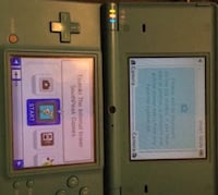 Dsi + charger and two games Winnipeg, R3A 1E3