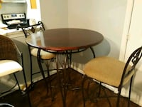round brown wooden table with four chairs dining set Prince William County, 22192
